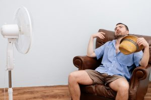 flushed-man-in-front-of-fan