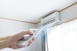 hand-holding-remote-to-ductless-air-handler