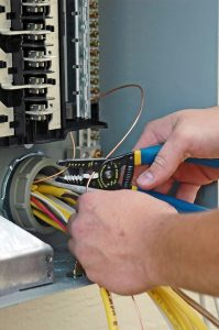 electrician-working-on-electrical-panel