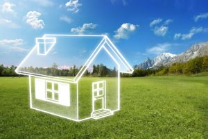 transparent-home-with-green-grass-and-blue-sky-in-background-efficiency-concept