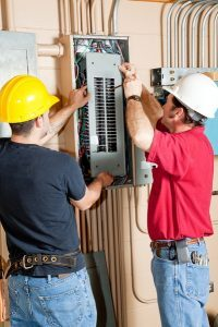 2-electricians-working-on-electrical-panel