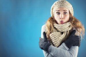 woman-looking-cold-imposed-on-blue-background