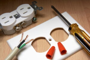 electrical-outlet-with-screwdriver-and-wire-on-table
