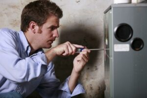 technician-working-on-furnace-system
