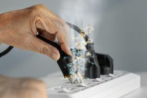 cord-being-plugged-in-with-sparks